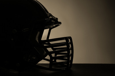 American Football Helmet Against Dark Background