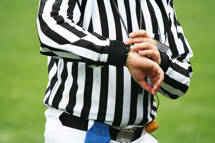 American Football Referee Checking Time