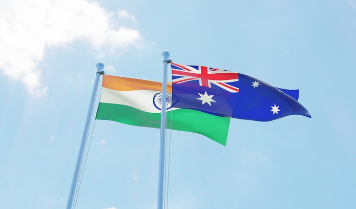 Australia and India Flags Against Blue Sky
