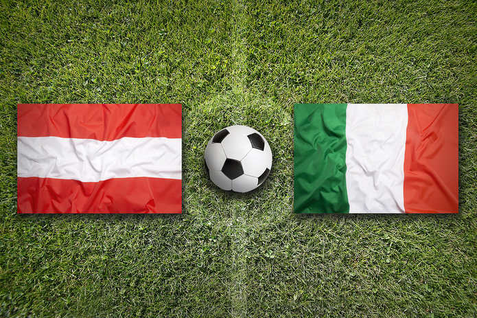 Austria and Italy Flags on Football Pitch