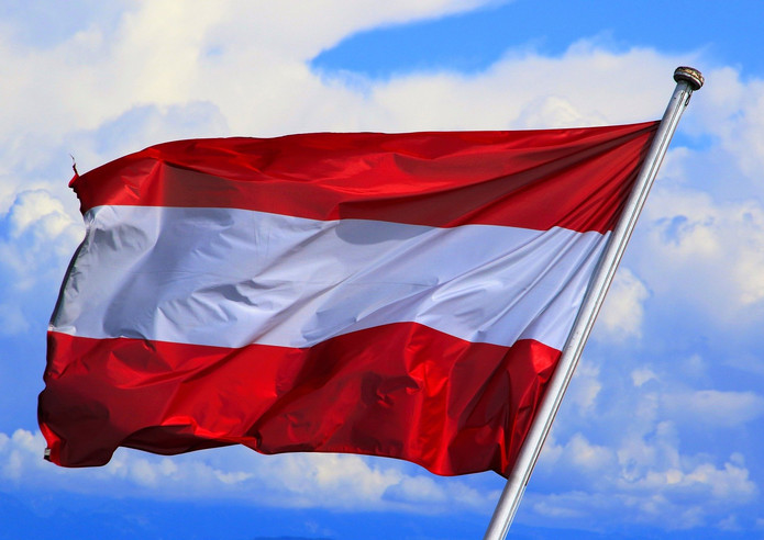 Austrian Flag Against Blue Sky