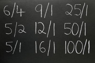 Betting Odds Written On Blackboard