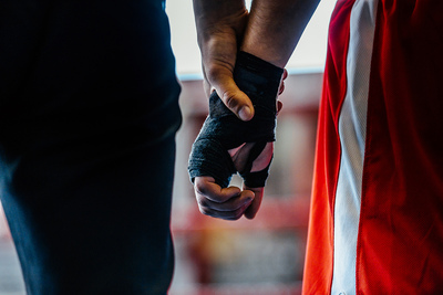 Boxer and Referees Hands Before Fight Announcement