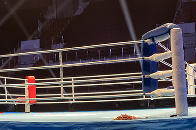 Empty Boxing Ring Inside an Arena
