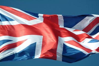 British Flag Waving Against Blue Sky