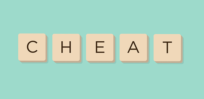 Cheat Spelled Out in Scrabble Tiles