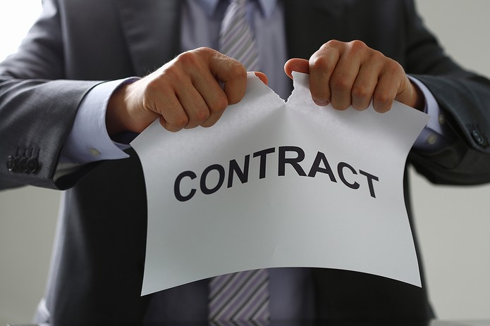 Contract Being Torn Up