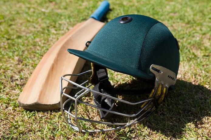 Cricket Bat and Green Helmet
