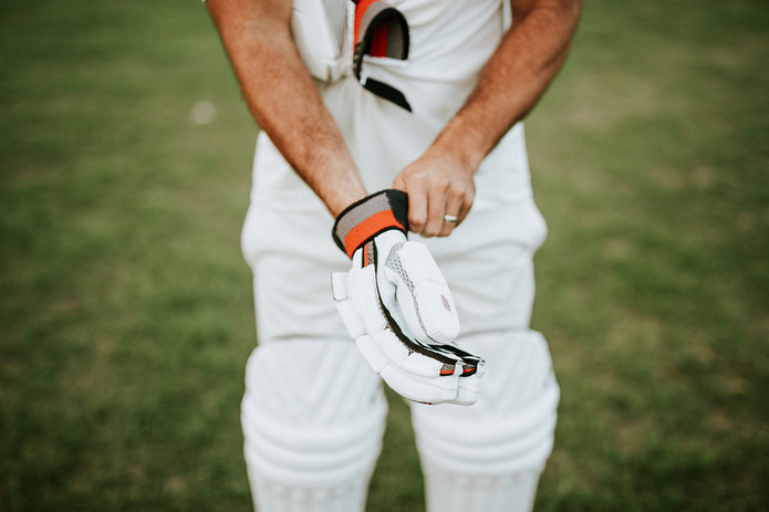 Cricket Player and Gloves