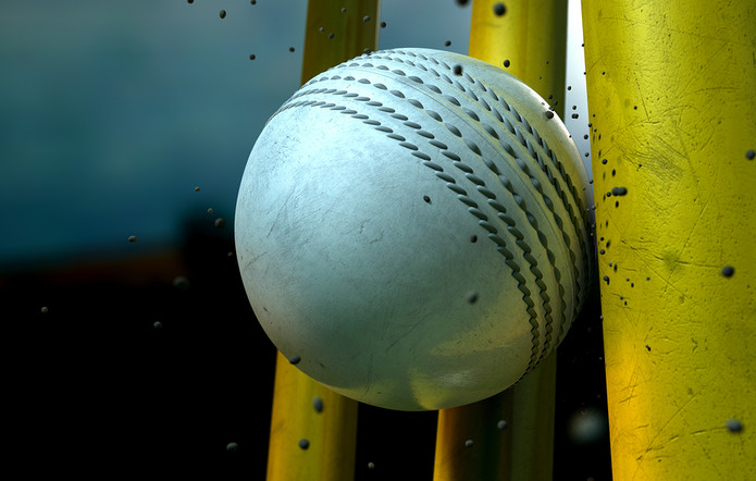 White Cricket Ball Hitting Yellow Wicket