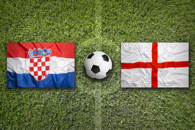 Croatia and England Flags on Football Pitch