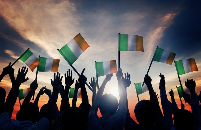 Crowd Waving Irish Flags