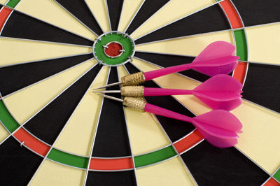 Dart Board with Pink Darts