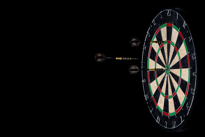 Dartboard Against Black Background
