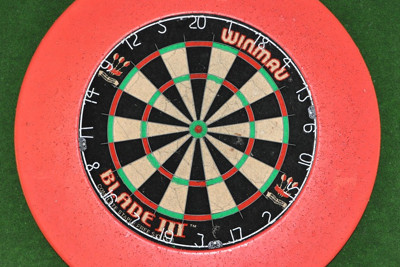 Dartboard with Red and Green Background