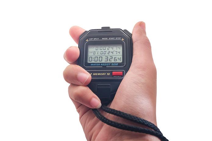 Hand Holding Digital Stopwatch