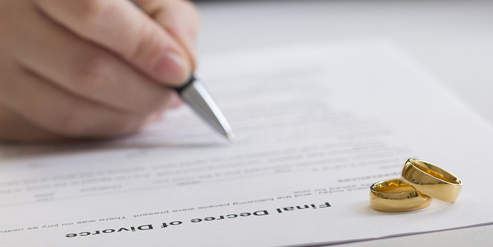 Divorce Settlement Being Signed