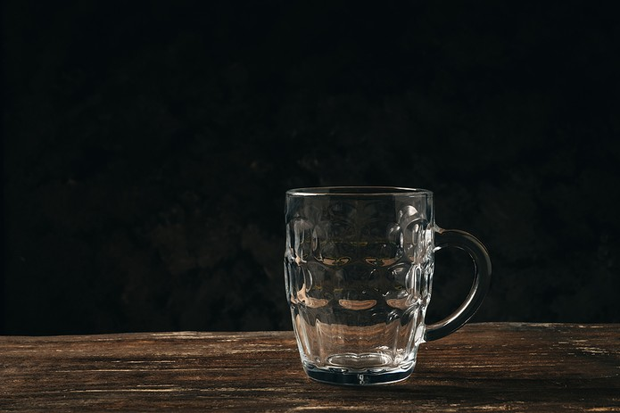 Empty Beer Glass on Wooden Table
