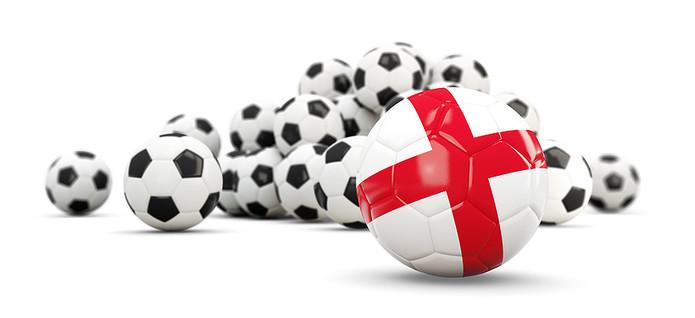 England Flag Football In Front of Regular Footballs
