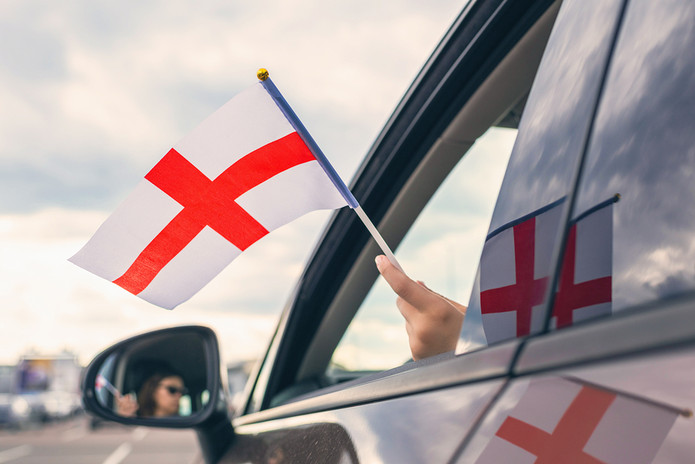 England Flag Held Out of Car Window