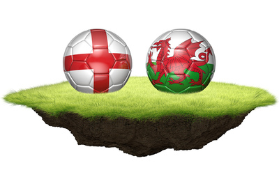 England and Wales Footballs on Patch of Turf