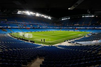 Floodlit Etihad Stadium in Manchester England