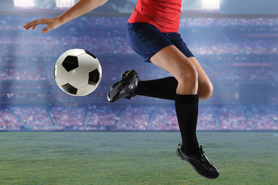 Female Footballer Controlling Ball