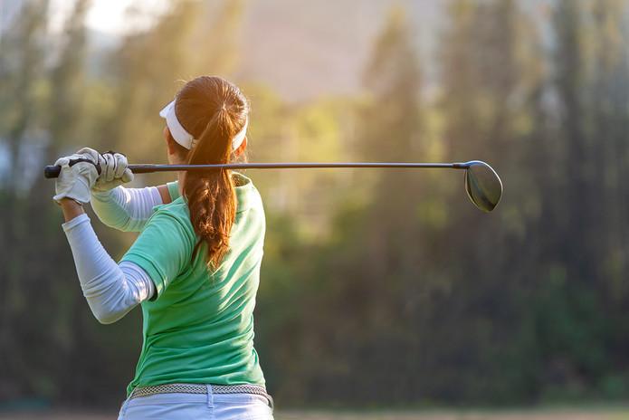Female Golfer Tee Shot