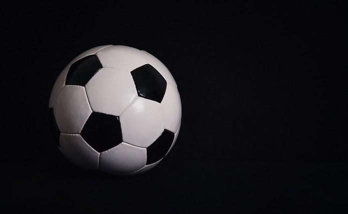 Football Against Black Background
