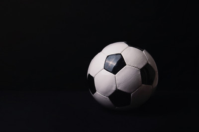 Football Against Dark Background