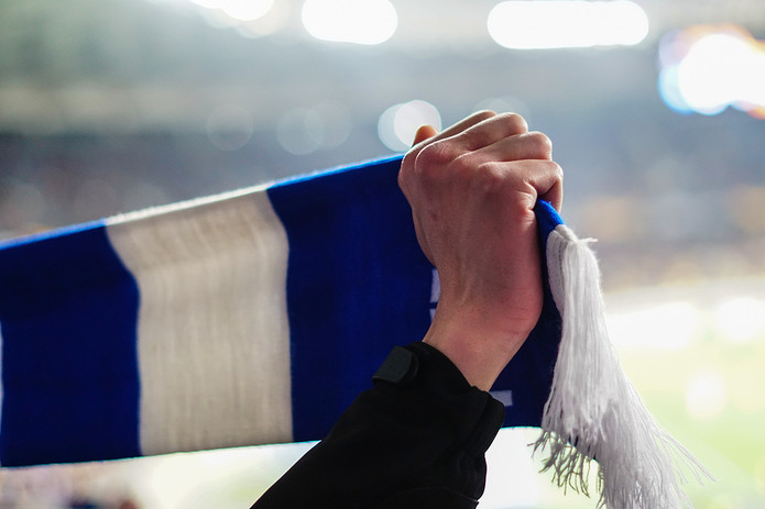 Football Fan with Blue and White Scarf