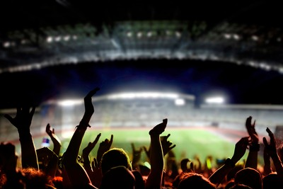 Football Fans Clapping in Stadium
