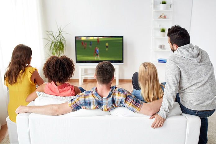 Football Fans Watching Game on Sofa