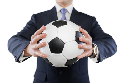 Football Manager Holding Ball