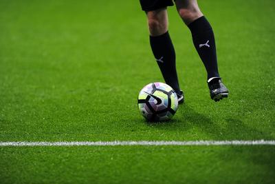 Football Player with Black Socks