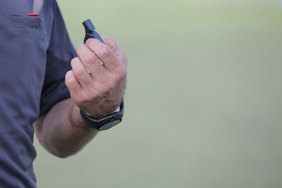 Football Referee Holding Whistle