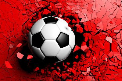 Football Shattering Red Wall