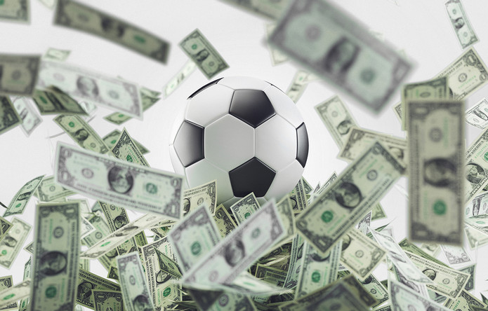 Football Surrounded by Dollar Bills