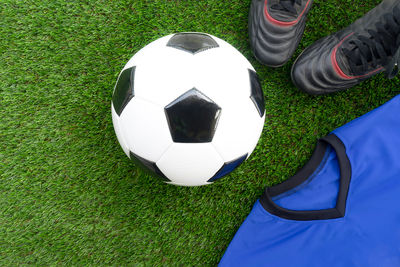 Football with Blue Shirt and Black Boots