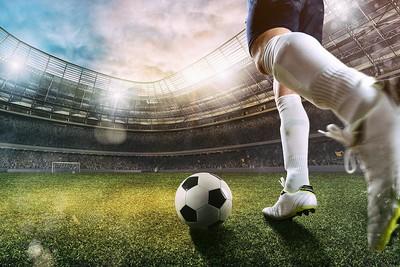 Footballer in Stadium Scene