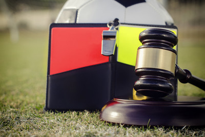 Gavel, Cards, Whistle and Ball on Football Pitch