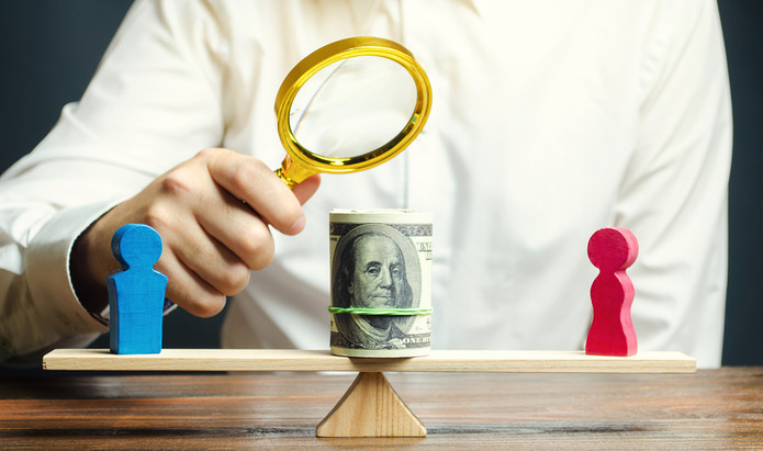 Gender Pay Gap Balance Looked at by Magnifying Glass