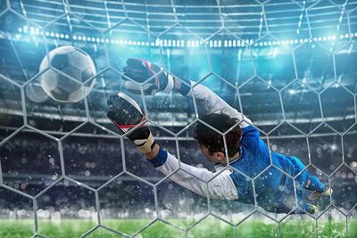 Goalkeeper Diving Towards Ball