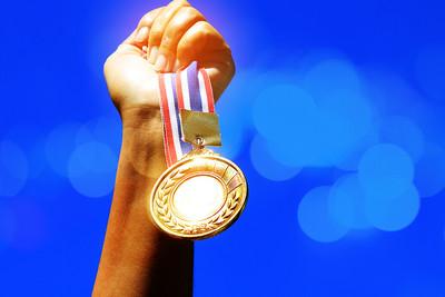 Gold Medal Against Blue Background