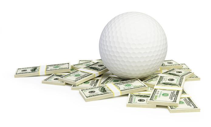 Golf Ball on Stacks of 100 Dollar Bills