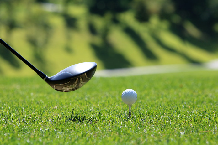 Golf Ball on Tee with Driver