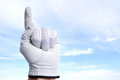 Golfer Holding Up Number 1