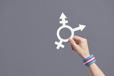 Hand Holding Transgender Symbol