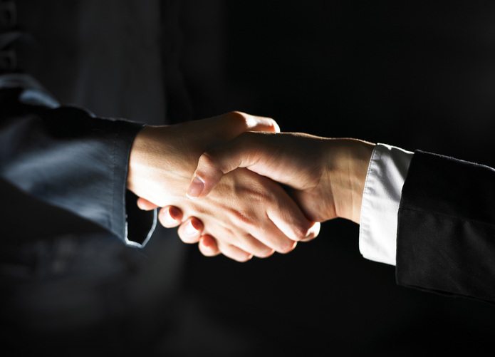 Handshake Dark Background