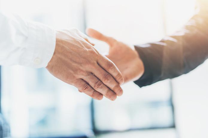 Handshake with Businessman Wearing White Shirt